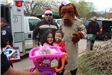 Kids with Toys and McGruff the Crime Dog