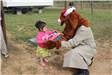 McGruff Giving Little Girl Toy