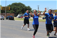 People Waving While Running