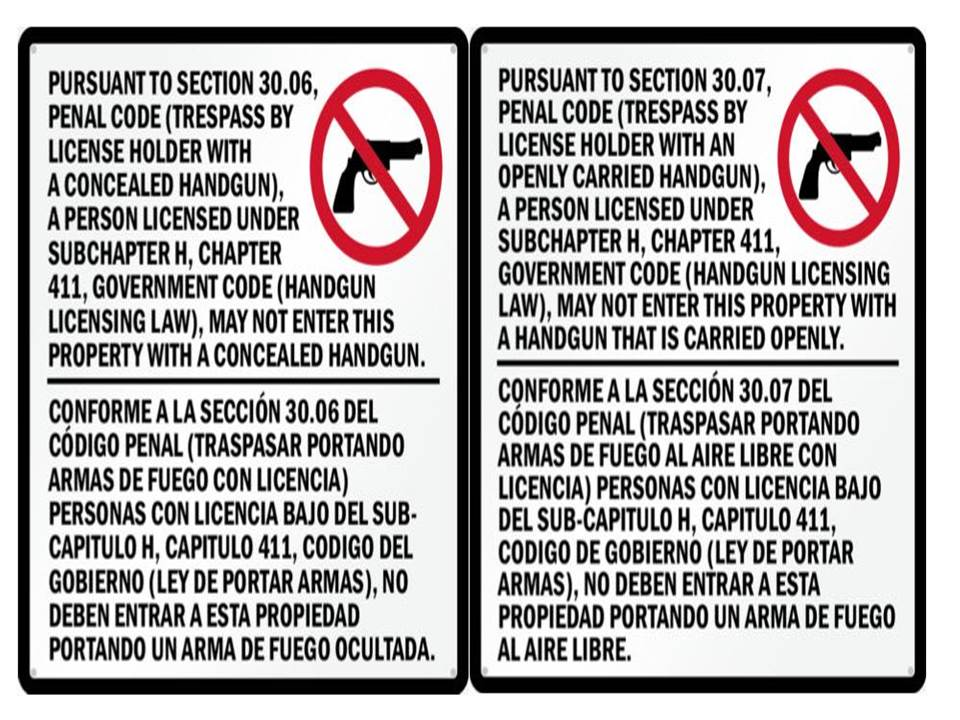 A sign detailing the prohibition of concealed or openly carried guns in the municipal court.