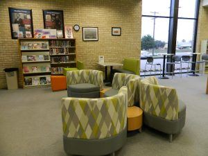 The Pearsall Public Library includes modern comfortable seating.