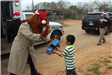 McGruff Handing out Toys