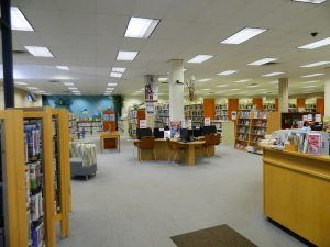 A view of shelving and seating in the Pearsall Public Library.