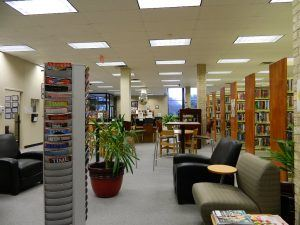Another view of shelving and seating in the Pearsall Public Library.